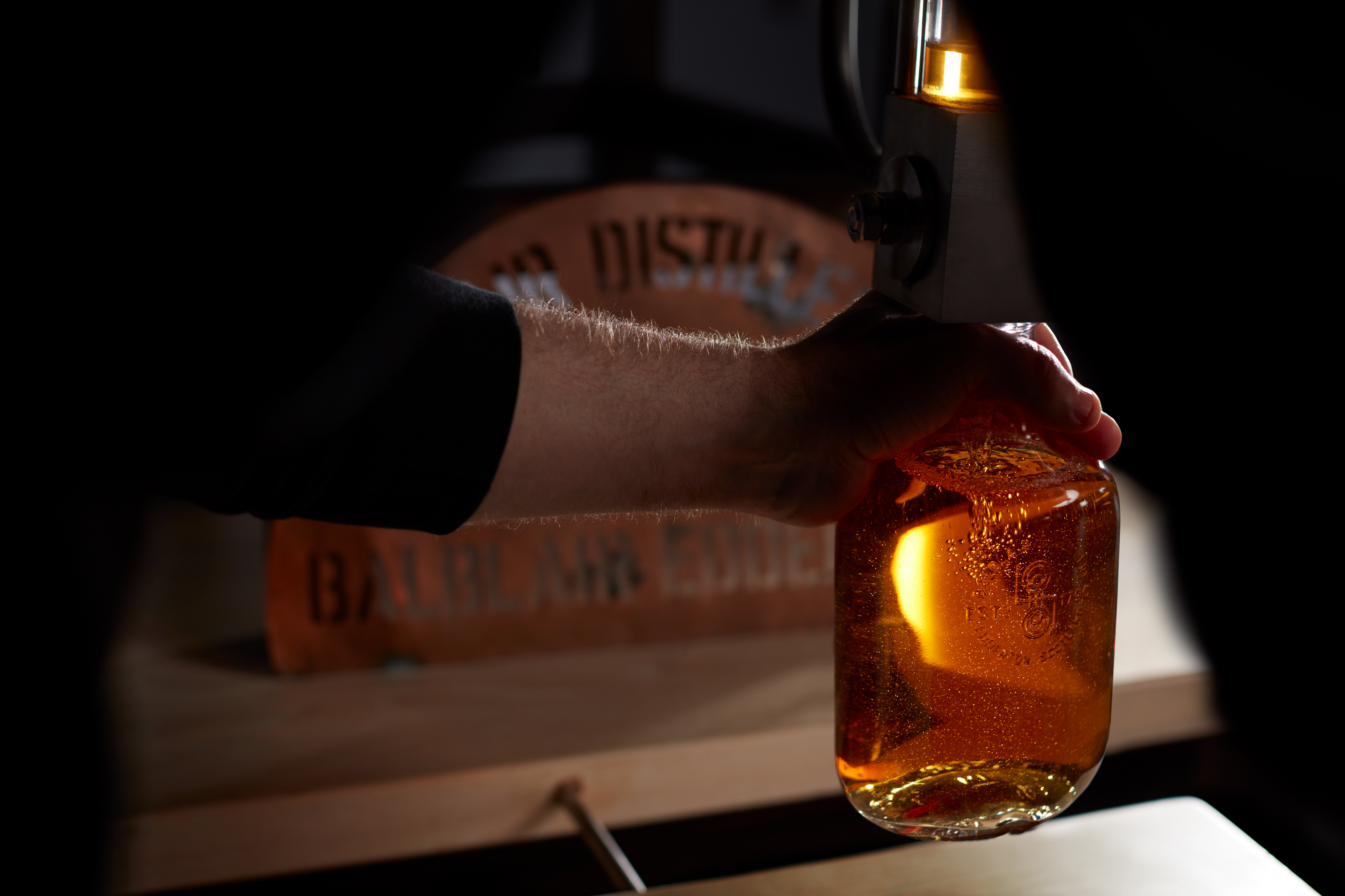 Balblair Whisky hand bottle - we welcome visitors to buy a bottle from a hand-selected cask which you can fill, cork, seal and label yourself.
